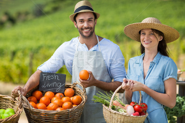 Smiling man and woman standing by fresh vegetables at farmer market Stock photo © wavebreak_media
