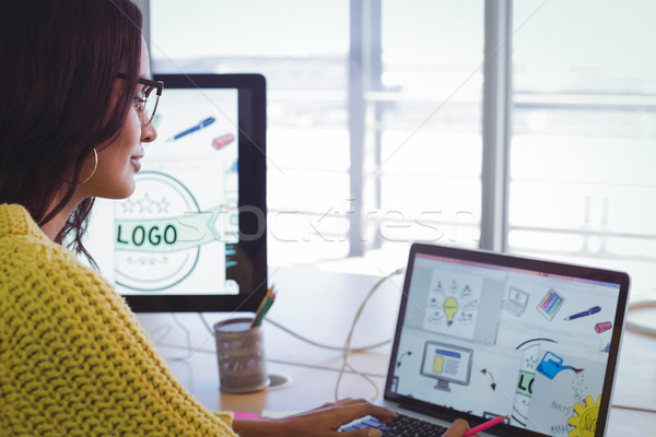 Stock photo: Female graphic designer working in office