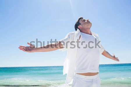 Happy man taking selfie against blue sky at beach Stock photo © wavebreak_media