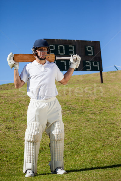 Cricket player holding bat while standing on field Stock photo © wavebreak_media