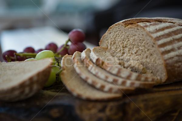 Brown bread and grapes in plate Stock photo © wavebreak_media