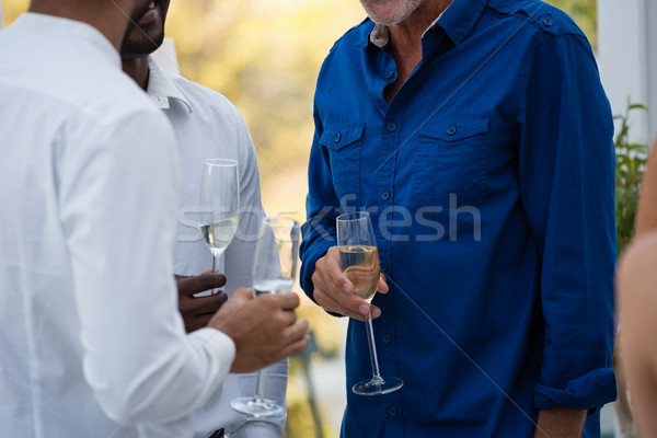 Mid section of friends holding wine glasses Stock photo © wavebreak_media
