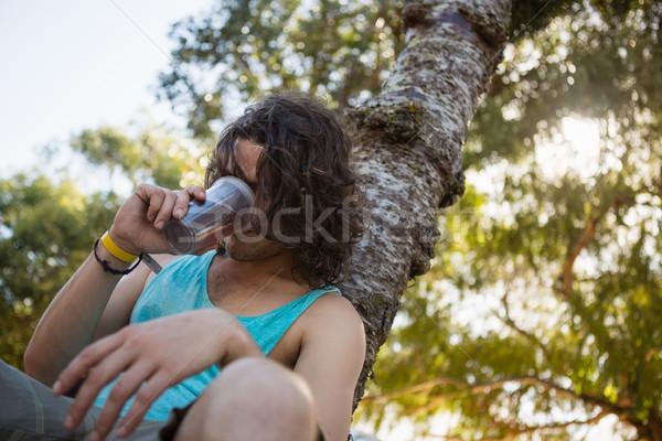 Hombre potable cerveza parque inconsciente solo Foto stock © wavebreak_media
