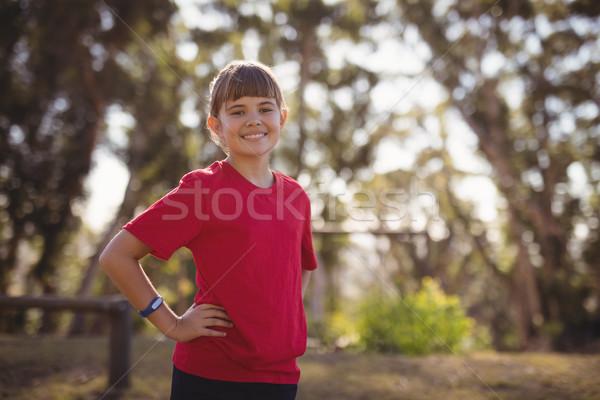 Portré mosolyog lány áll kezek csípő Stock fotó © wavebreak_media