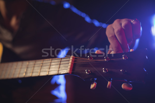 Mid section of musician adjusting tuning peg Stock photo © wavebreak_media