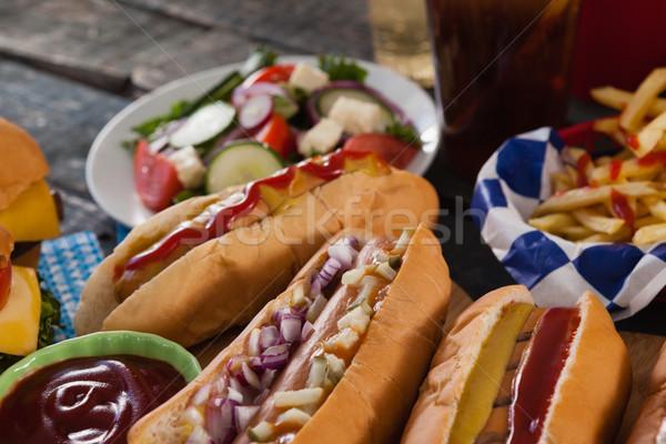 Sıcak köpekler ketçap ahşap masa gıda Stok fotoğraf © wavebreak_media