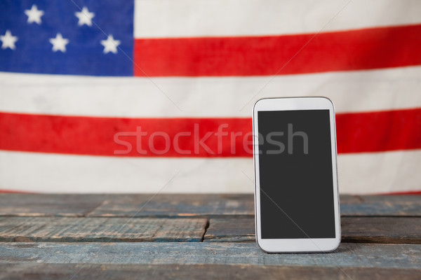Digital comprimat American Flag masa de lemn albastru Imagine de stoc © wavebreak_media