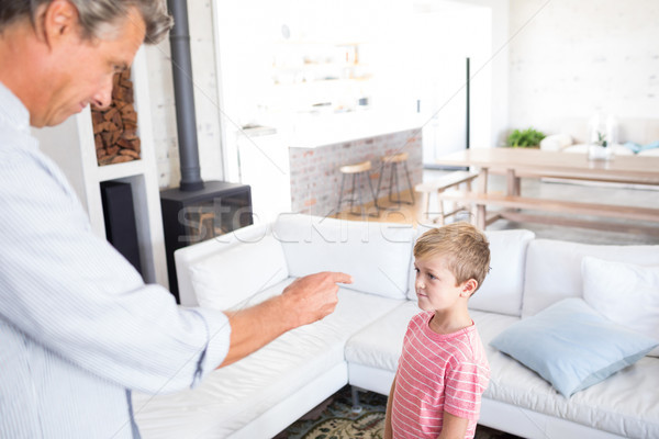 Angry father scolding his son in living room Stock photo © wavebreak_media