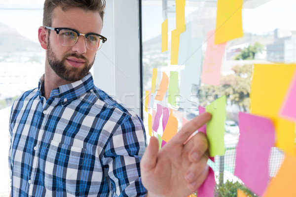 Erkek yürütme işaret yapışkan not ofis genç Stok fotoğraf © wavebreak_media