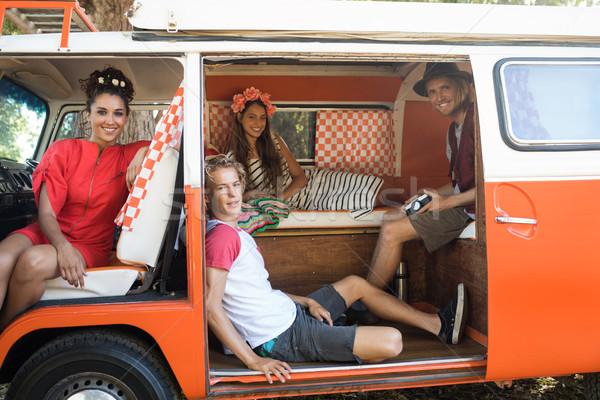 Portrait of friends sitting resting in camper van Stock photo © wavebreak_media
