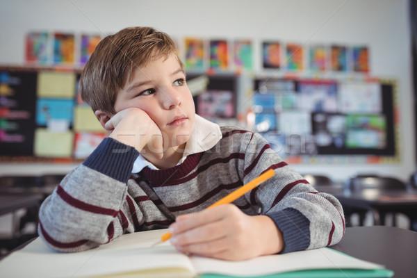 Menino sessão secretária sala de aula livro Foto stock © wavebreak_media