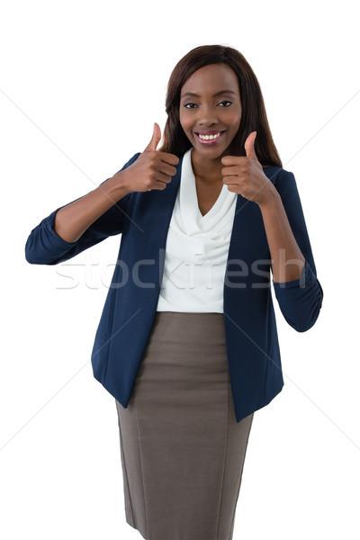 Portrait of smiling businesswoman showing thumbs up Stock photo © wavebreak_media