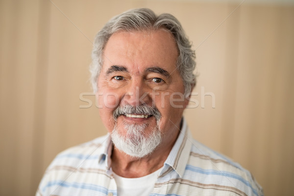 Close-up portrait of senior man against wall Stock photo © wavebreak_media
