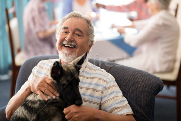 портрет улыбаясь старший человека сидят щенков Сток-фото © wavebreak_media