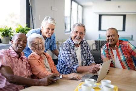 Healthcare worker serving coffee to senior people Stock photo © wavebreak_media