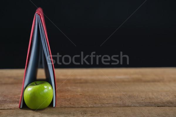 Alma könyv fa asztal közelkép iskola diák Stock fotó © wavebreak_media