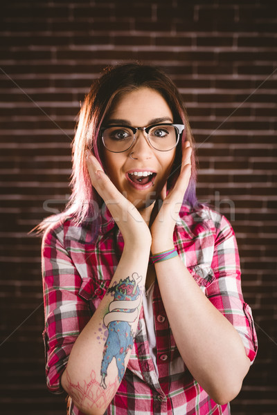 Portrait of shocked woman in spectacles Stock photo © wavebreak_media