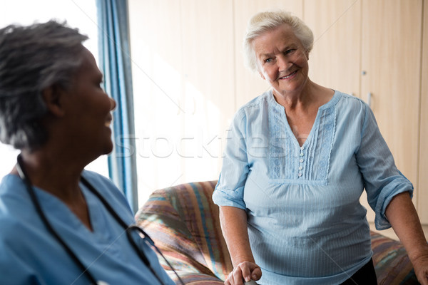 Smiling nurse and senior woman looking at each other Stock photo © wavebreak_media