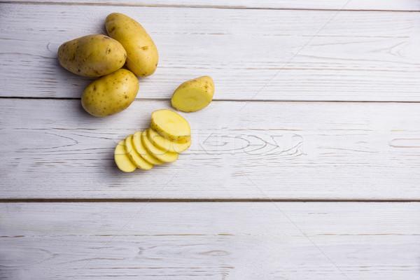 De pomme de terre tranches table coup studio bois Photo stock © wavebreak_media
