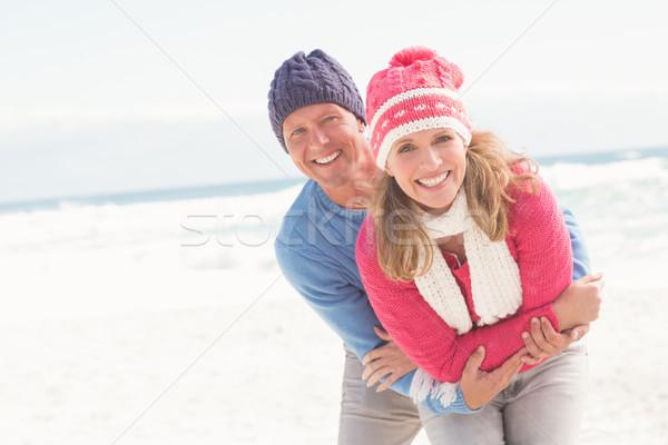 Sonriendo feliz Pareja otro playa Foto stock © wavebreak_media