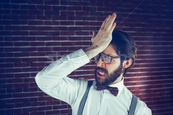 Frustrated hipster with head in hand  Stock photo © wavebreak_media