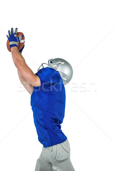American football player catching ball Stock photo © wavebreak_media