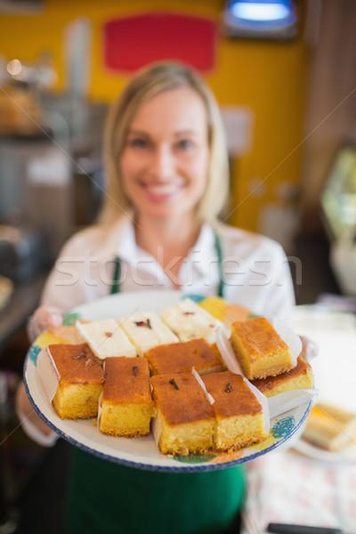Female worker serving pastries Stock photo © wavebreak_media