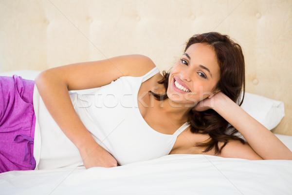 улыбающаяся женщина кровать домой счастливым женщины спальня Сток-фото © wavebreak_media
