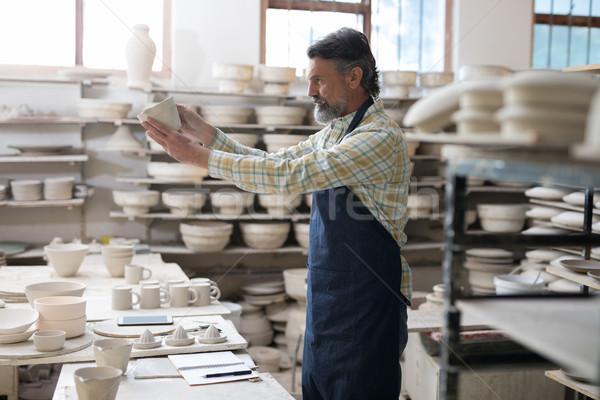 Male potter checking craft product Stock photo © wavebreak_media