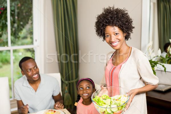 Sorridente mãe comida mulher criança Foto stock © wavebreak_media