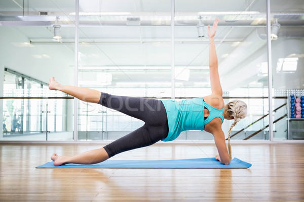 Fit blonde doing exercise on mat Stock photo © wavebreak_media