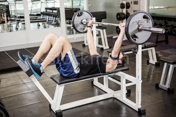 мышечный человека штанга скамейке спортзал Сток-фото © wavebreak_media
