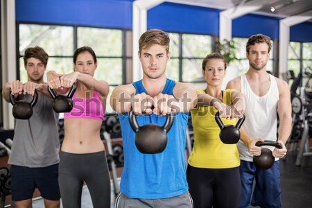 Athletic men and women working out  Stock photo © wavebreak_media