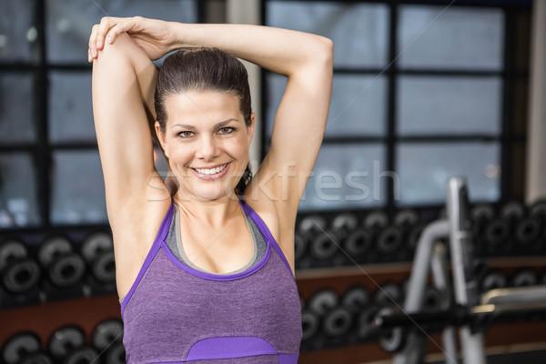 Gülen esmer silah spor salonu kadın Stok fotoğraf © wavebreak_media