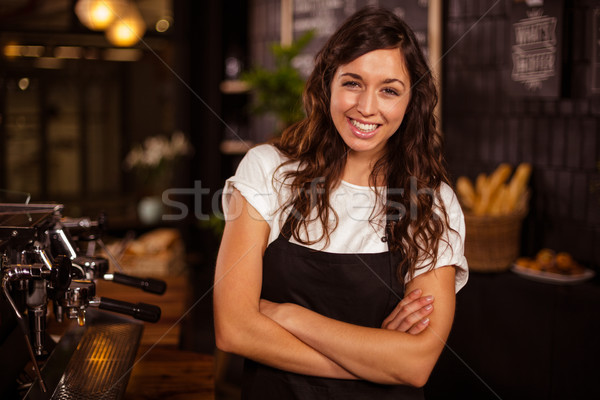 Pretty waitress posing with arms crossed next to coffee machine Stock photo © wavebreak_media