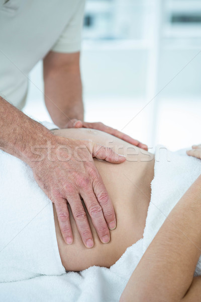 Femme enceinte estomac massage masseur femme Photo stock © wavebreak_media