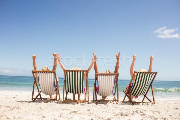 Kıdemli arkadaşlar oturma şezlong plaj kadın Stok fotoğraf © wavebreak_media