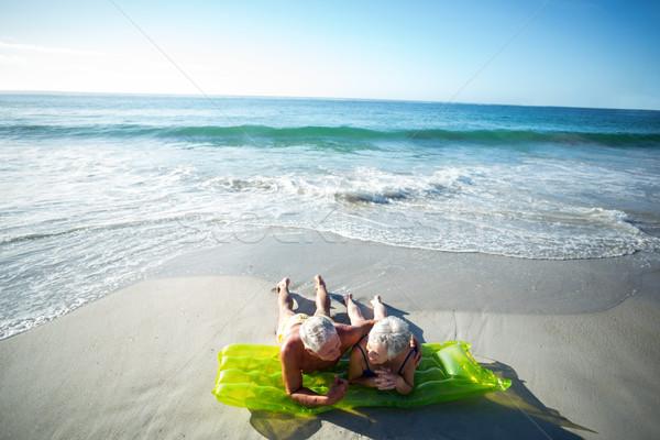 Casal de idosos ar colchão praia mulher homem Foto stock © wavebreak_media