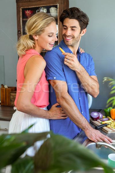 Man feeding his woman in kitchen Stock photo © wavebreak_media