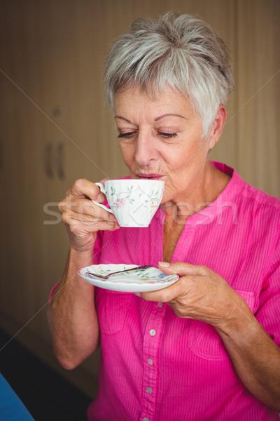 Portrait of a smiling woman drinking a tea Stock photo © wavebreak_media