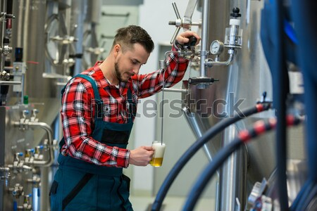Portrait of maintained worker leaning on machine Stock photo © wavebreak_media