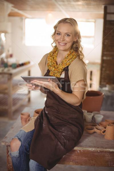 Beautiful female potter using digital tablet Stock photo © wavebreak_media