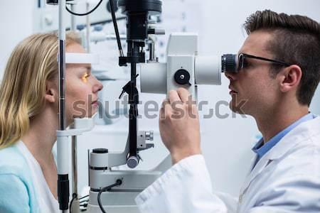 Optometrista femminile paziente lampada ritratto Foto d'archivio © wavebreak_media