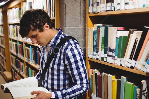 Student reading book in college library Stock photo © wavebreak_media