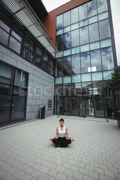 Empresária ioga escritório mulher mão Foto stock © wavebreak_media