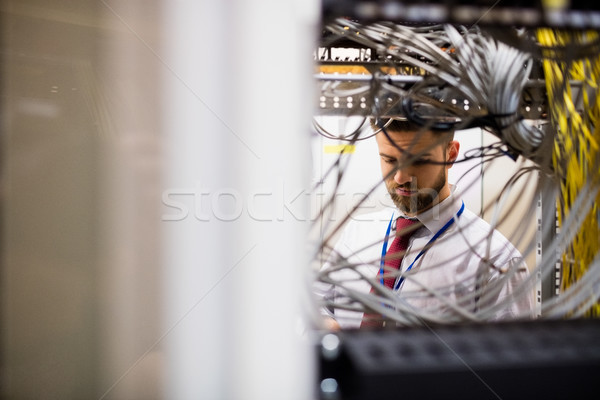 Technician checking cables in a rack mounted server Stock photo © wavebreak_media