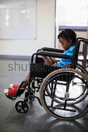 Ritratto femminile infermiera paziente sedia a rotelle corridoio Foto d'archivio © wavebreak_media
