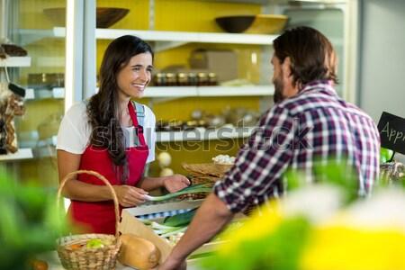 Tensed woman checking bill in kitchen Stock photo © wavebreak_media