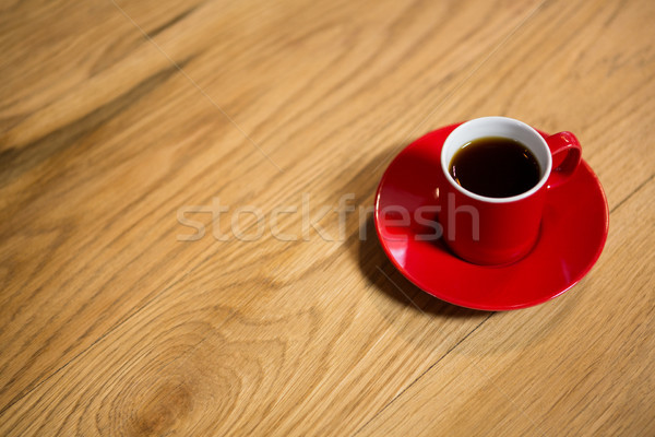 Red cup and saucer on table in cafeteria Stock photo © wavebreak_media