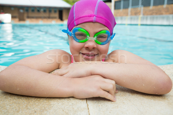 Portrait of young girl wearing swimming goggles in pool Stock photo © wavebreak_media